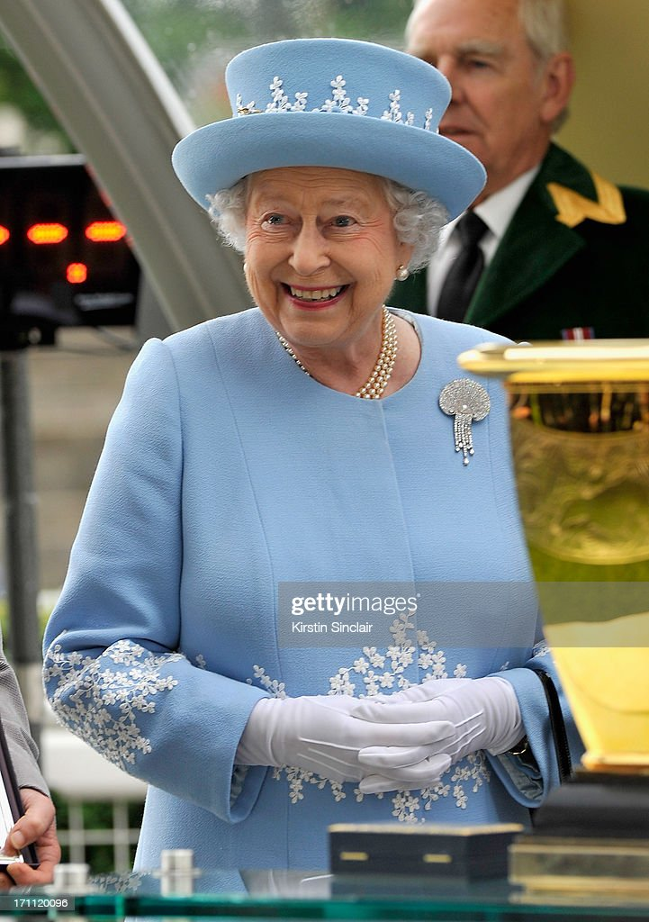Queen Elizabeth II smiles as she presents Diamond Jubilee Stakes trophy attends day five of Royal Ascot at Ascot Racecourse on June 22, 2013 in Ascot, England.
