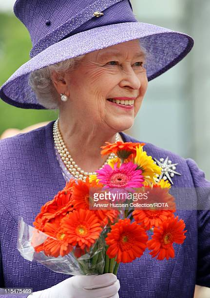 HM Queen Elizabeth II smiles as she receives a bunch of flowers from wellwishers following a Remembrance Service commemorating 25 years since the...