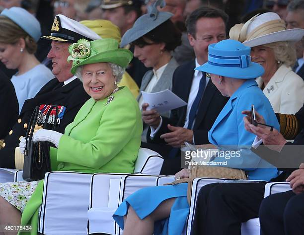 Queen Elizabeth II smiles as she sits near British Prime Minister David Cameron, Samantha Cameron, Camilla, Duchess of Cornwall and Queen Margrethe...