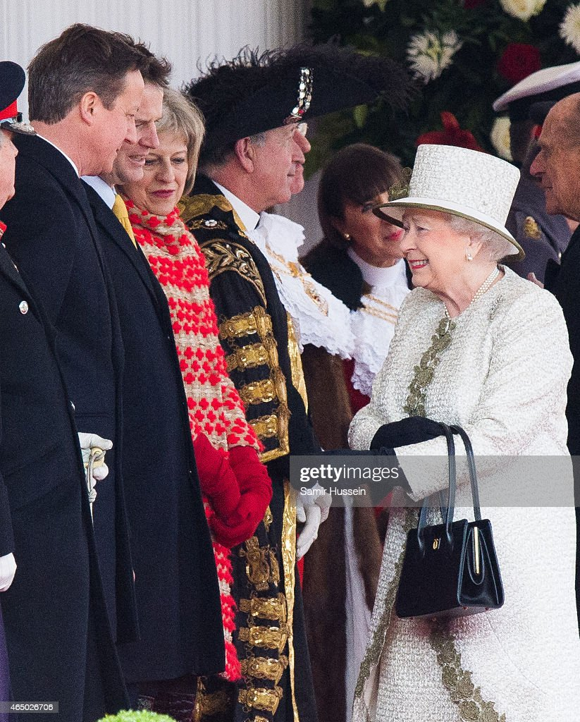 Queen Elizabeth II smiles as she talks to (L-R) British Prime Minister David Cameron, Liberal Democrats leader Nick Clegg and Home Secretary Theresa May as they attend a ceremonial welcome for The President Of United Mexican States at Horse Guards Parade on March 3, 2015 in London, England.
