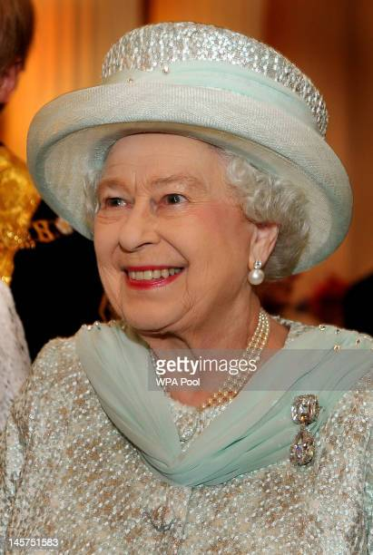 Queen Elizabeth II smiles as she talks to guests in the Egyptian room of Mansion House, for a reception hosted by the Lord Mayor of London and the...