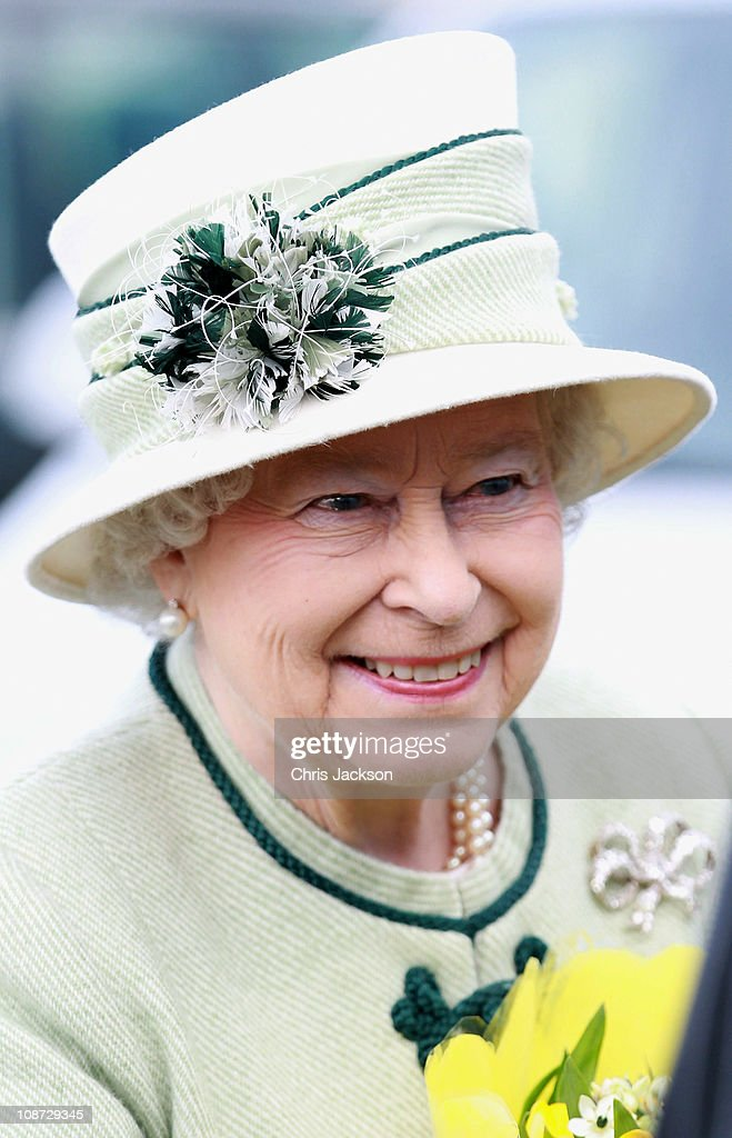 Queen Elizabeth II smiles as she visits Palm Paper on February 2, 2011 in Norwich, England. The Queen and Duke of Edinburgh are visiting sites today, which include the Palm Paper mill and West Norfolk Deaf Association in King's Lynn.