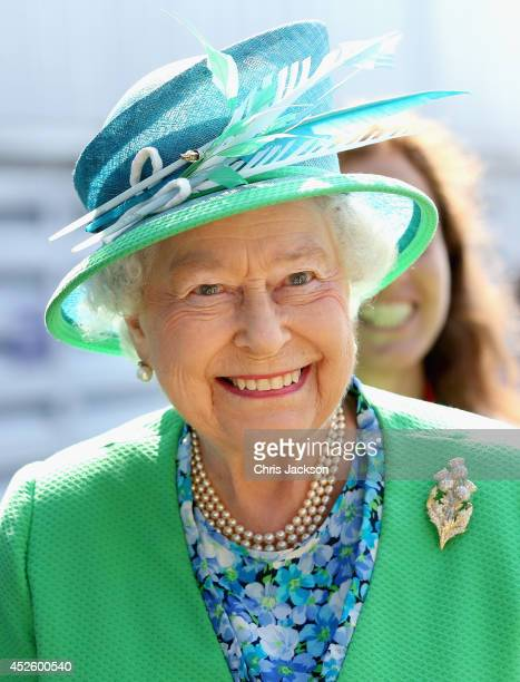 Queen Elizabeth II smiles as she visits the Glasgow National Hockey Centre to watch the hockey during day one of 20th Commonwealth Games on July 24,...
