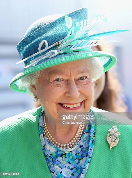 Queen Elizabeth II smiles as she visits the Glasgow National Hockey Centre to watch the hockey during day one of 20th Commonwealth Games on July 24...
