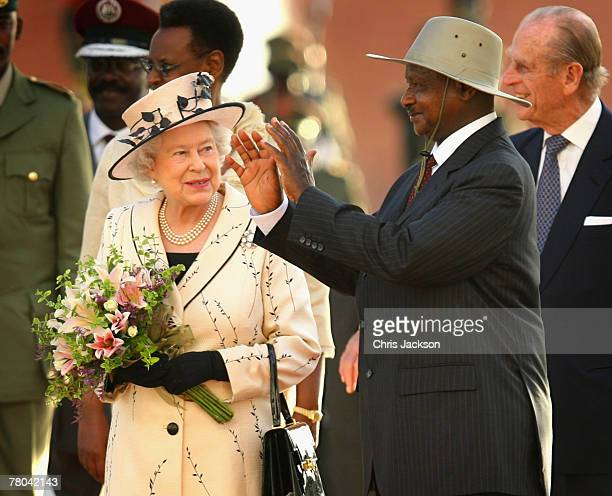 Queen Elizabeth II smiles as the President of Uganda Yoweri Museveni gestures at State House on November 21 2007 in Entebbe Uganda The Queen will...