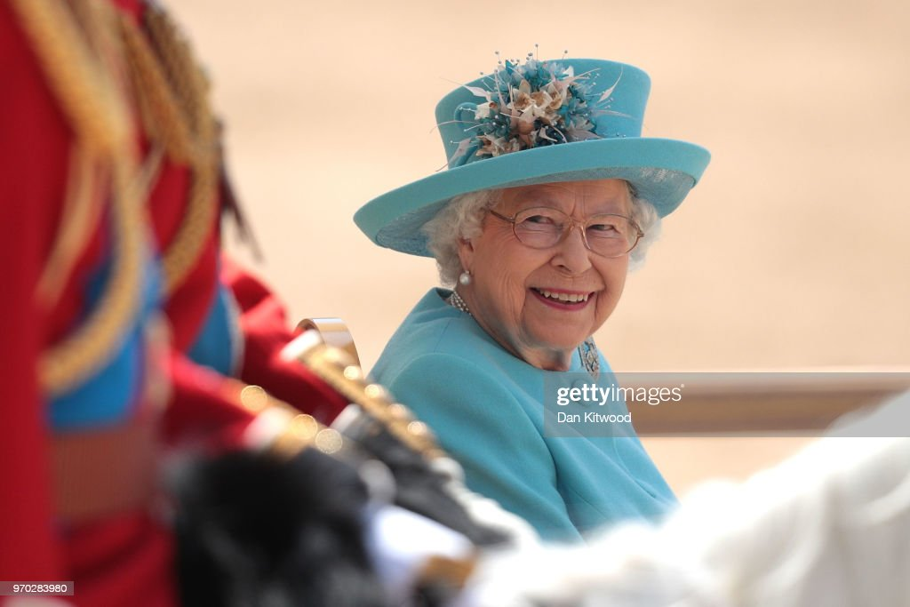 Queen Elizabeth II smiles at Prince William, Duke of Cambridge during Trooping The Colour ceremony at The Royal Horseguards on June 9, 2018 in London, England. The annual ceremony involving over 1400 guardsmen and cavalry, is believed to have first been performed during the reign of King Charles II. The parade marks the official birthday of the Sovereign, even though the Queen's actual birthday is on April 21st.