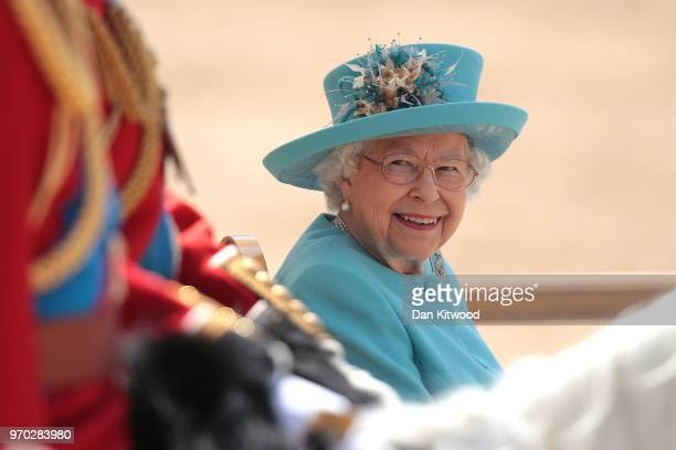 Queen Elizabeth II smiles at Prince William Duke of Cambridge during Trooping The Colour ceremony at The Royal Horseguards on June 9 2018 in London...