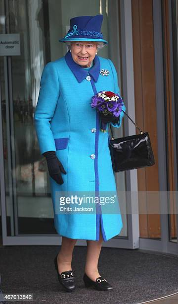 Queen Elizabeth II smiles at Schoolchildren as she leaves the National Memorial to the Few after opening a new wing on March 26 2015 in Folkestone...