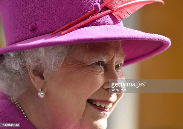 Queen Elizabeth II smiles during a Queen's Trust visit to the Lister Community School in Plaistow on March 3 2016 in London England