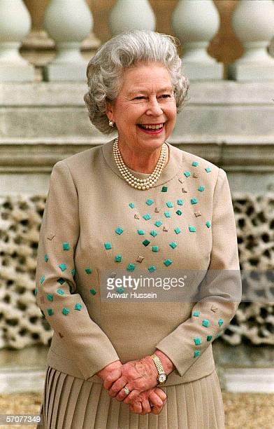 Queen Elizabeth II smiles in the grounds of Buckingham Palace on June 12th, 1998.