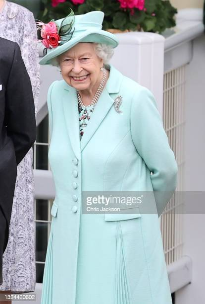 Queen Elizabeth II smiles in the parade ring as she attends Royal Ascot 2021 at Ascot Racecourse on June 19, 2021 in Ascot, England.