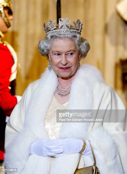 Queen Elizabeth II Smiling As She Arrives At The Palace Of Westminster For The State Opening Of Parliament. The Queen Is Wearing A Diamond Crown...