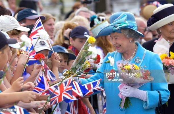 Queen Elizabeth II Smiling As She Continues Her Jubilee Tour Greeting Crowds Of Wellwishers With Union Jack Flags And Receiving Flowers