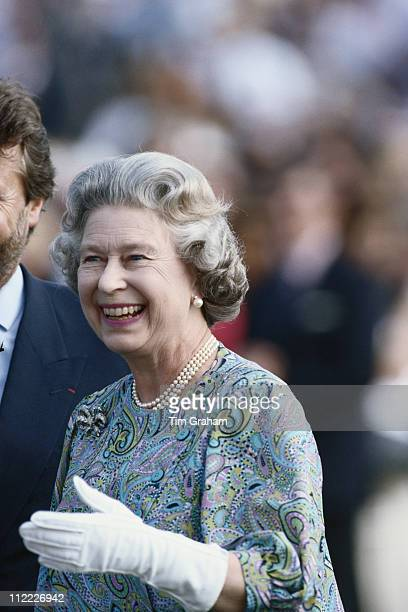 Queen Elizabeth II smiling while presenting prizes at the Cartier International Polo Day held at the Guards Polo Club Smith's Lawn in Windsor...