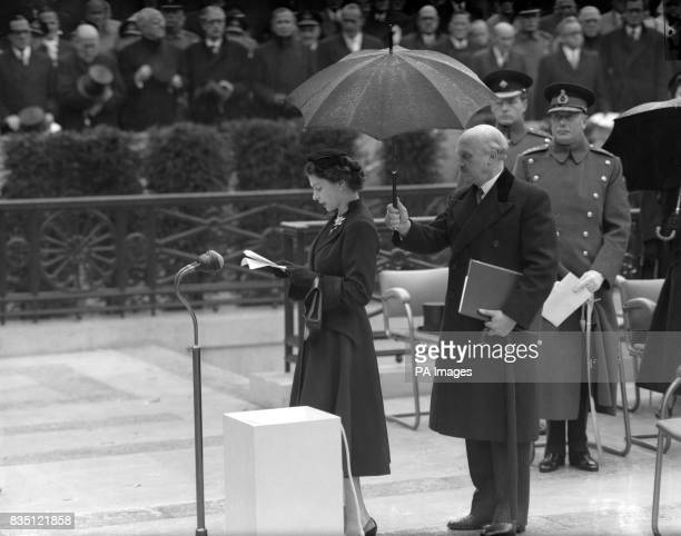 Queen Elizabeth II speaking at the unveiling of the national memorial to her father the late King George VI in Carlton Gardens London By her is the...