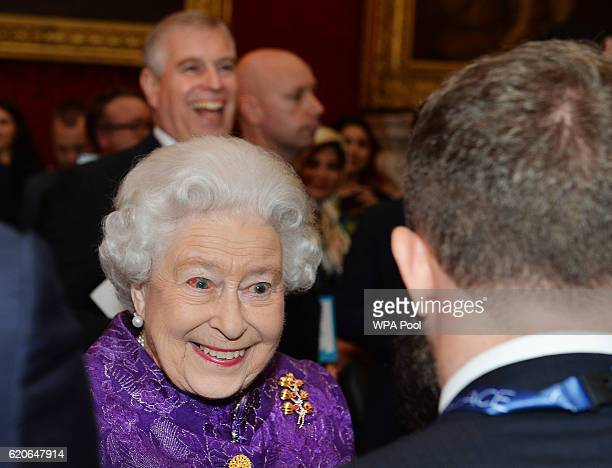 Queen Elizabeth II speaks to Ed Leon Klinger during the opening of Pitch@Palace 60 an initiative set up by the Duke of York to guide help and connect...