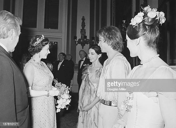 Queen Elizabeth II speaks to Margot Fonteyn and Rudolf Nureyev after a gala performance at Covent Garden to mark the 35th anniversary of Margot...
