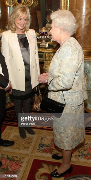 Queen Elizabeth II speaks to model Twiggy at a reception for the British Clothing Industry, including an exhibition of contemporary clothing curated...