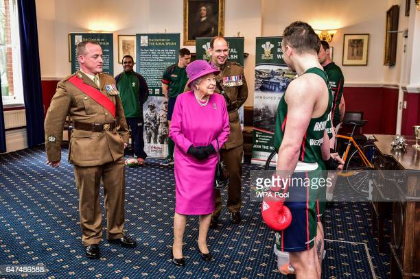 Queen Elizabeth II speaks to soldiers as she visitsThe Royal Welsh Regimental Family to mark St David's Day at Lucknow Barracks on March 3 2017 in...