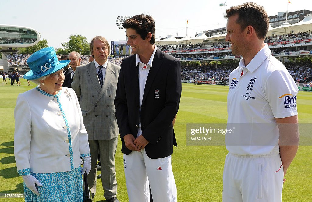 Queen Elizabeth II speaks with England captain Alastair Cook and Graeme Swann (right) ahead of the first day of the second test between England and Australia at Lord's Cricket Ground on July 18, 2013 in London, England.