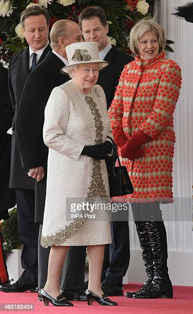 Queen Elizabeth II speaks with Home Secretary Theresa May as they await the arrival of the President of Mexico, Enrique Pena Nieto and his wife...
