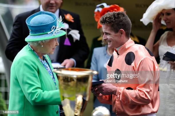 Queen Elizabeth II speaks with jockey Luke Nolen after he rode Black Caviar to win the Diamond Jubilee Stakes during day 5 of Royal Ascot at Ascot...