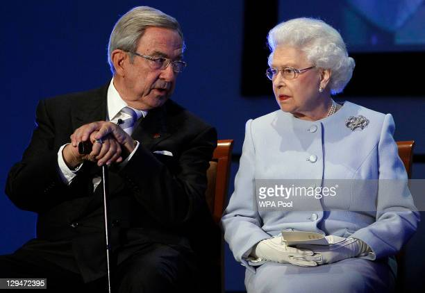 Queen Elizabeth II speaks with King Constantine of Greece during the opening ceremony of the Round Square International Conference at Wellington...