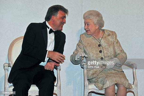 Queen Elizabeth II speaks with President of Turkey Abdullah Gul during a ceremony and reception in Whitehall on November 9 2010 in London England...