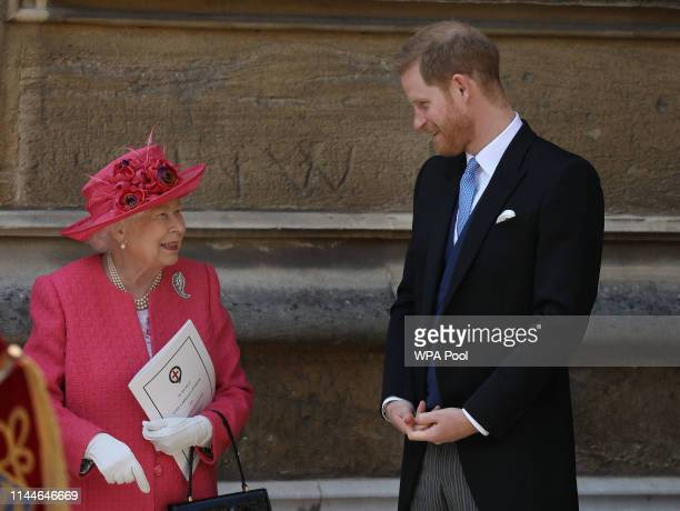 Queen Elizabeth II speaks with Prince Harry, Duke of Sussex as they leave after the wedding of Lady Gabriella Windsor to Thomas Kingston at St...