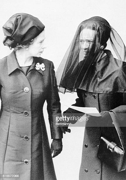 Queen Elizabeth II speaks with the Duchess of Windsor outside Windsor Castle June 5th following funeral services for the Duke of Windsor Two hundred...