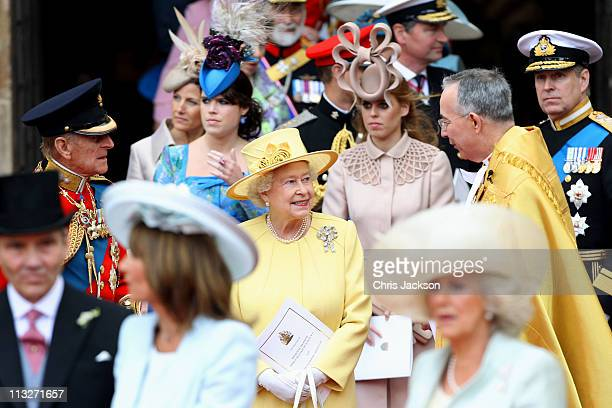 Queen Elizabeth II speaks with The Very Reverend Dr John Hall Dean of Westminster following the marriage of Prince William Duke of Cambridge and...