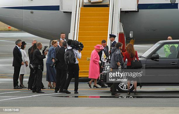 Queen Elizabeth II speaks with West Australian Governor Malcolm McCusker at Perth International Airport on October 26, 2011 in Perth, Australia. The...