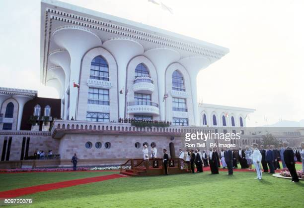 Queen Elizabeth II standing alongside the Sultan of Oman Sultan Qaboos bin Said as they take the salute during the playing of the National Anthem in...