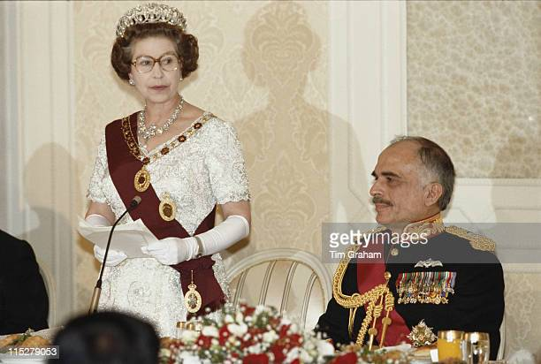 Queen Elizabeth II standing beside King Hussein of Jordan as she makes a speech at a state banquet held in her honour at the Basman Palace in Amman...