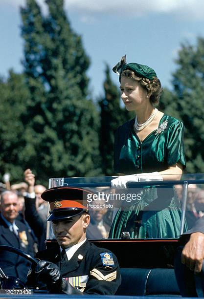 Queen Elizabeth II standing on a Land Rover at a gathering of 600 exservicemen and women on the lawns of Parliament House Canberra during her Royal...