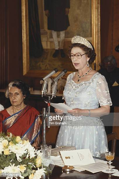 Queen Elizabeth II standing to make a speech at a banquet, also attended by Indian Prime Minister Indira Gandhi , in Delhi, India, 18 November 1983....