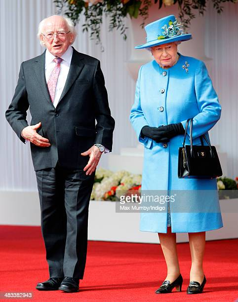 Queen Elizabeth II stands alongside Irish President Michael D Higgins during his ceremonial welcome on April 8 2014 in Windsor England This is the...