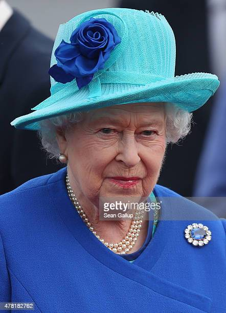 Queen Elizabeth II stands arrives with Prince Philip the Duke of Edinburgh at Tegel airport on the first of their fourday visit to Germany on June 23...