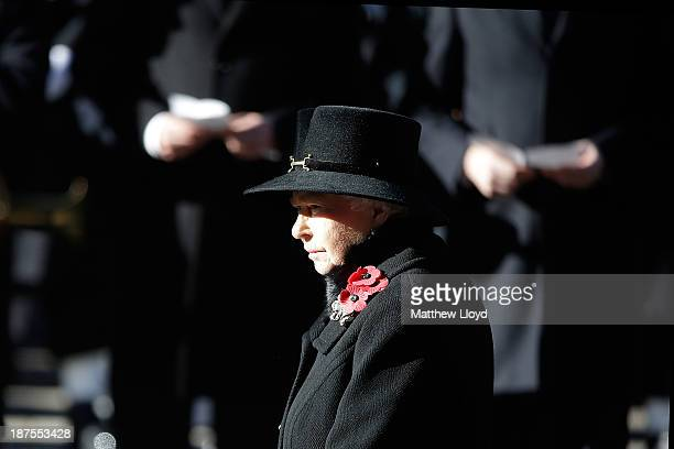 Queen Elizabeth II stands in front of the Cenotaph during a wreath laying ceremony on Whitehall on November 10 2013 in London United Kingdom People...