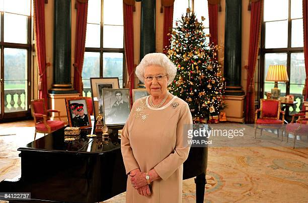 Queen Elizabeth II stands in the music room of Buckingham Palace after recording her Christmas day message to the Commonwealth on December 22 2008 in...