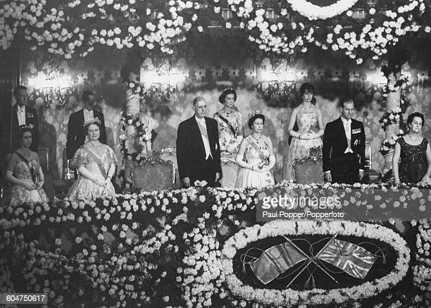 Queen Elizabeth II stands in the Royal Box with Princess Margaret Queen Elizabeth the Queen Mother President Charles de Gaulle of France Prince...