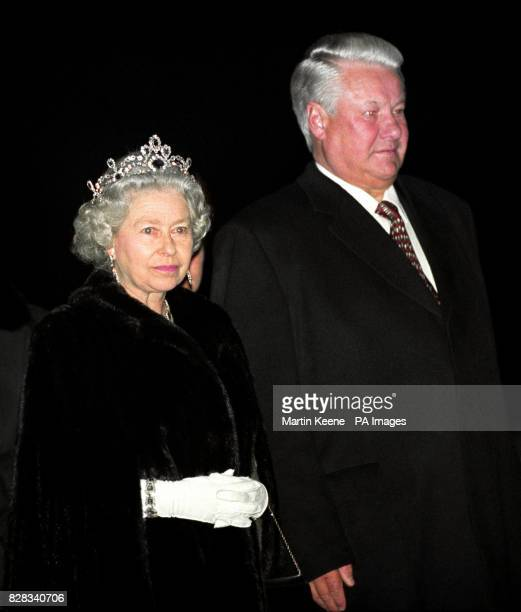 Queen Elizabeth II stands next to Russian President Boris Yeltsin as a guard of honour marches by after a banquet on the Royal Yacht