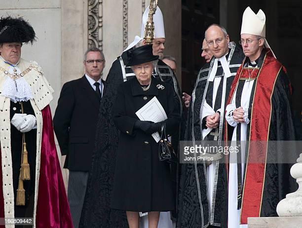 Queen Elizabeth II stands with The Most Reverend Justin Welby Archbishop of Canterbury after the ceremonial funeral of former British Prime Minister...