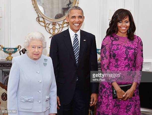Queen Elizabeth II stands with US President Barack Obama and First Lady of the United States Michelle Obama in the Oak Room at Windsor Castle ahead...