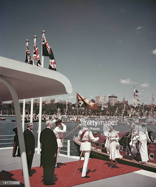 Queen Elizabeth II steps off the royal barge at Farm Cove in Sydney Australia becoming the first reigning monarch of Australia to set foot in the...
