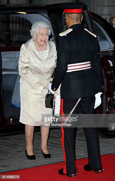 Queen Elizabeth II steps out her Bentley car as she arrives to attend a reception and awards ceremony at the Royal Academy of Arts on October 11 2016...