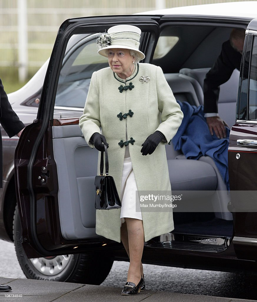 Queen Elizabeth II steps out of her Bentley car as she arrives at the Palm Paper mill on February 2, 2011 in Norwich, England. The Queen and the Duke of Edinburgh are visiting several sites today, including the Palm Paper mill and West Norfolk Deaf Association in King's Lynn.