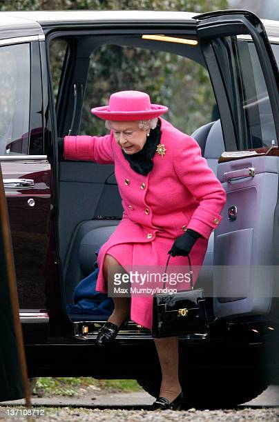 Queen Elizabeth II steps out of her Bentley car as she arrives at the church of St Mary in Flitcham near the Sandringham Estate to attend Sunday...