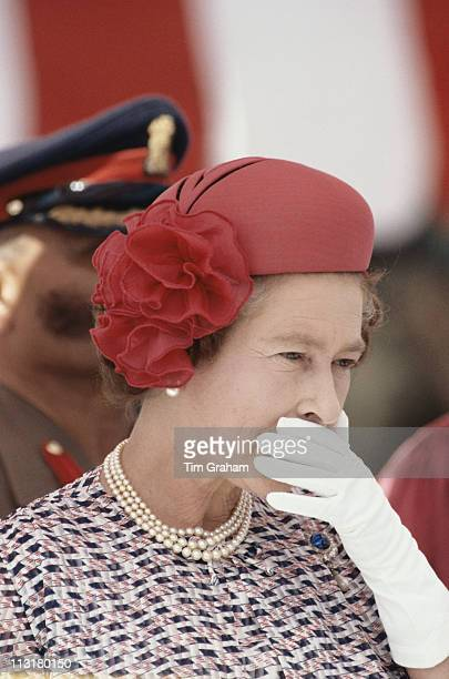 Queen Elizabeth II stifling a yawn during a visit to the Indian National Defence Academy in Pune, India, 21 November 1983. The Queen was on a...