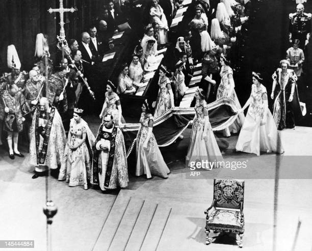 Queen Elizabeth II surrounded by the bishop of Durham Lord Michael Ramsay and the bishop of Bath and Wells Lord Harold Bradfield walks to the altar...